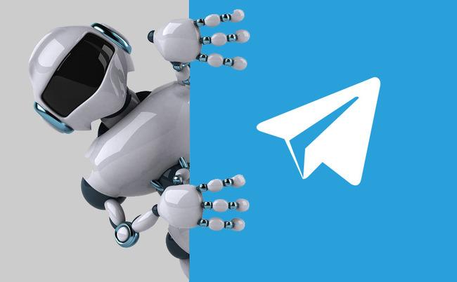 Робот рядом с лого TG